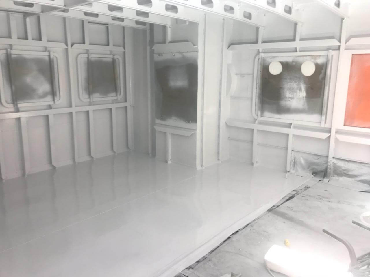 Sandblasting and epoxy coating